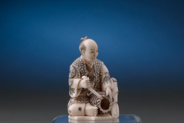 Ivory Figure Weaving a Basket