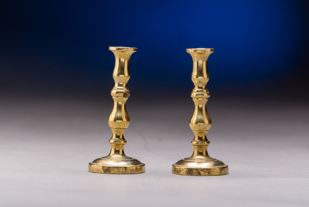 Pair of Miniature Brass Candlesticks on English origin, late 19th-early 20th .